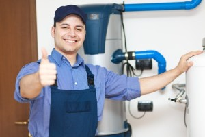 plumber fixing water heater